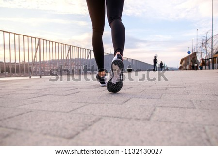 Closeup look of the shoes of a jogging women