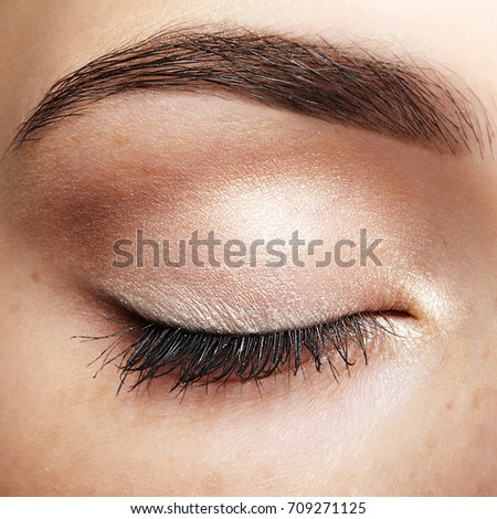 cb307010986 Closeup macro shot of closed human female eye. Woman with natural day face  beauty makeup