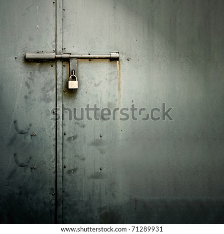 Closeup metal door with lock in grungy style and good texture. #71289931