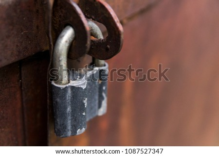 Closeup metal red grunge door with silver lock in grungy style and good texture.