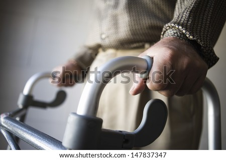 Closeup midsection of a man using walking frame Stock photo ©