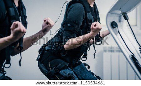 Closeup o two women squatting during EMS workout at gym Foto stock ©