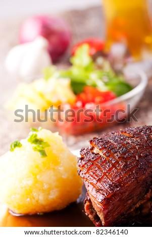 closeup of a bavarian roast pork dish - stock photo