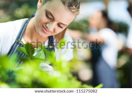 closeup of a beautiful florist working in garden