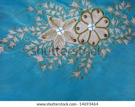 Closeup of a beautiful flower and leaves pattern embroidery.