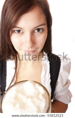 Closeup of a Beautiful woman holding Oktoberfest beer stein. Isolated on white.