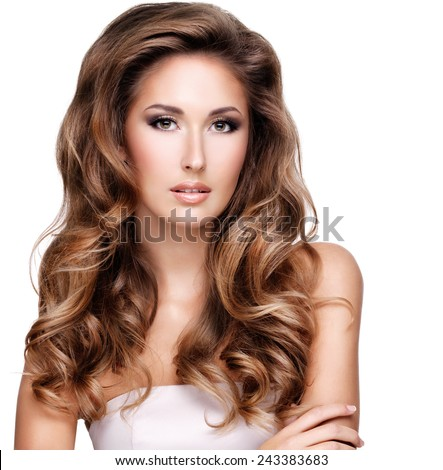 Closeup of a beautiful woman with long brown wavy hair, isolated on white