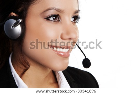 Closeup of a beautiful, young brunette woman with headset