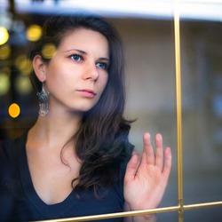 Closeup of a beautiful young russian girl posing at the window