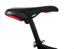 closeup of a bicycle saddle in the seat post on a white background