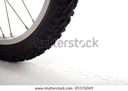 Closeup of a bicycle wheel with track on white surface