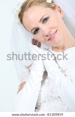 Closeup of a blonde woman in a wedding gown - stock photo