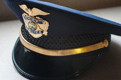 Closeup of a blue municipal Police Chief hat.  Alaska.