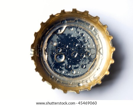Closeup of a bottle cap on a white background.