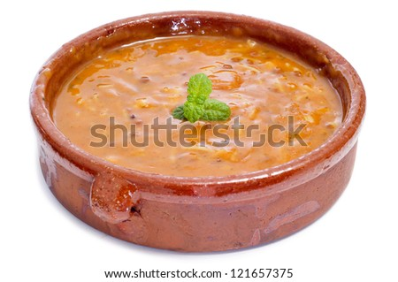 closeup of a bowl of harira, the traditional Berber soup of Morocco, on a white background