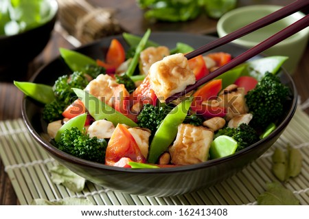 Closeup of a bowl of tofu and vegetable stir fry