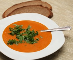 closeup of a bowl with pumpkin soup