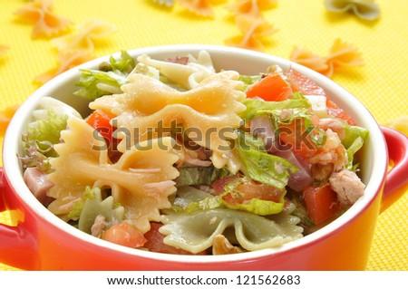 closeup of a bowl with refreshing pasta salad