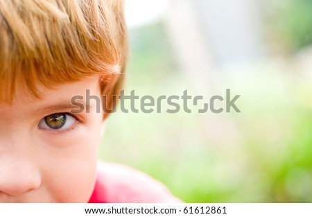 closeup of a boy's eyes with funny face
