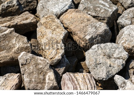 Closeup of a breakwater made of giant boulders by the sea, full frame. Liguria, Italy, Europe #1466479067