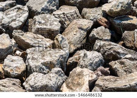Closeup of a breakwater made of giant boulders by the sea, full frame. Liguria, Italy, Europe #1466486132