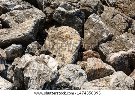 Closeup of a breakwater made of giant boulders by the sea, full frame. Liguria, Italy, Europe #1474350395
