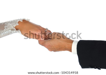 Closeup of a bride and groom holding hands isolated over a white background.