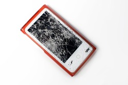 Closeup of a broken mp3 player with a shattered glass screen. Hope you are insured.