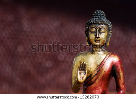 Closeup of a buddha statue in a zen pose