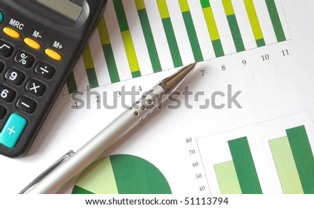 closeup of a business chart with pen and calculator