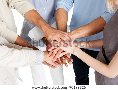 Closeup of a business colleagues with their hands stacked together