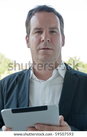 Closeup of a business salesman accessing his touchscreen PC