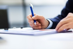 Closeup of a businessman at work on some documents