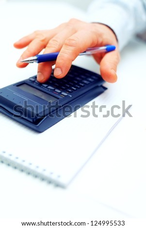 Closeup of a businessman calculating
