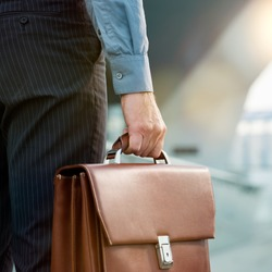 Closeup Of A Businessman Holding Briefcase Going To Work