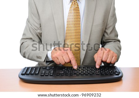 Closeup of a Businessman typing on a wireless keyboard. Man is seated at a desk and is unrecognizable. Horizontal format over white.