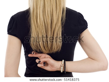 Closeup of a businesswoman with crossed fingers behind her back isolated over a white background