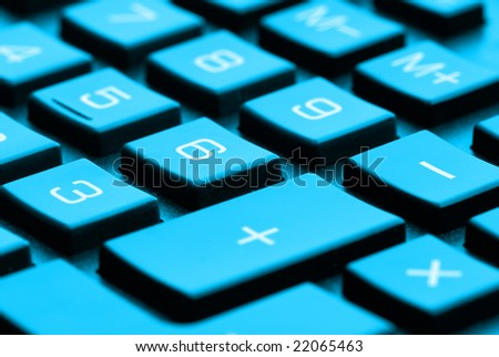 Closeup of a calculator keyboard - Shallow DOF, blue toning