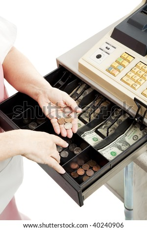Closeup of a cashier's hands making change in a cash register drawer.  Vertical view, white background.
