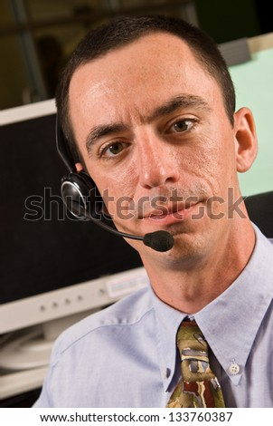 Closeup of a Caucasian Male Receptionist with Headset