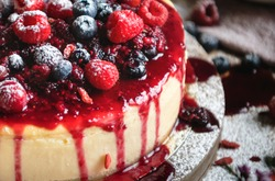 Closeup of a cheesecake covered with mixed berries