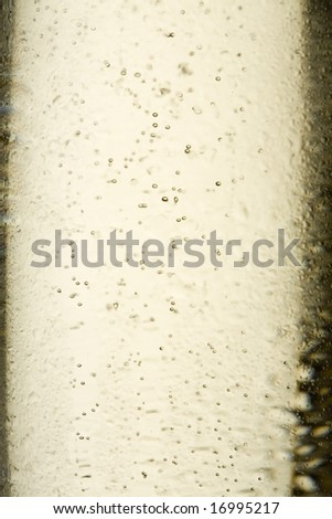 Closeup of a chilled champagne glass with bubbles