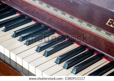 Closeup of a classical piano keyboard in perspective. The piano is an acoustic, stringed musical instrument, in which the strings are struck by hammers. It is played  using a keyboard.