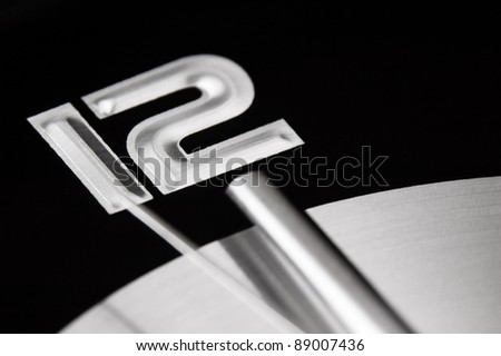 Closeup of a clock about to strike twelve
