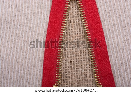 Closeup of a colorful  zipper on linen canvas #761384275