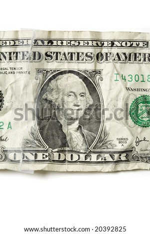 Closeup of a crumpled one dollar bill in United States Currency