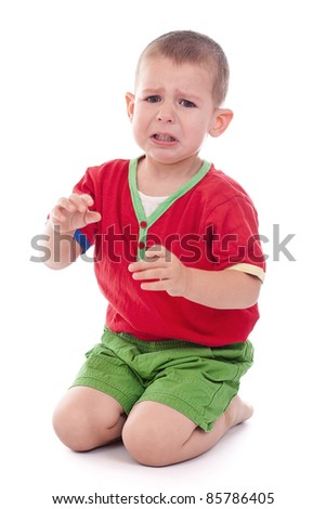 Closeup of a crying boy, studio shot, isolated on white