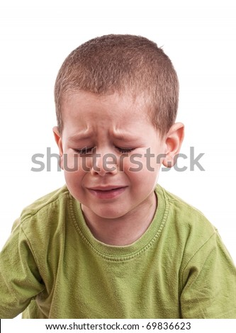 Closeup of a crying boy whit closed eyes