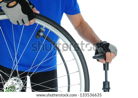 Closeup of a cyclist pumping up a bicycle tire. Man is unrecognizable and standing behind the wheel. Horizontal format over a white background.
