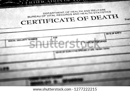 Closeup of a deather certificate symbolizing peron who passed away